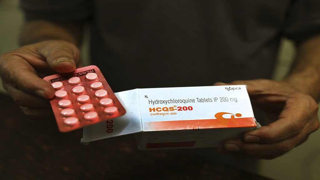 In this April 9, 2020 file photo, a chemist displays hydroxychloroquine tablets in New Delhi, India. (AP Photo/Manish Swarup, File)