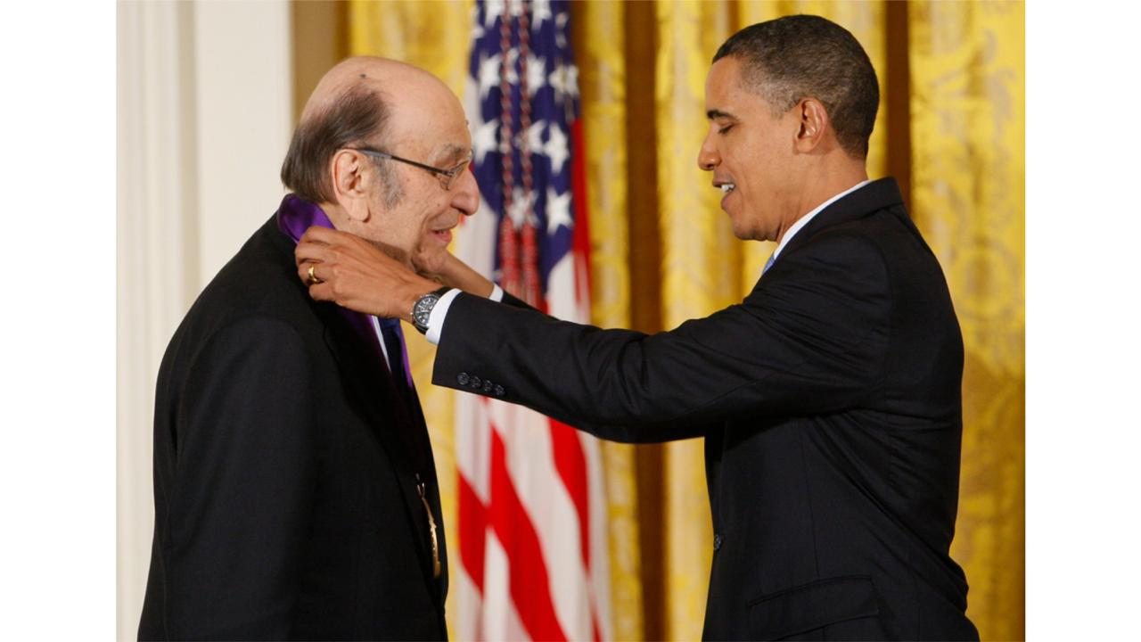 "In this Thursday, Feb. 25, 2010, file photo, President Barack Obama presents a 2009 National Medal of Arts to Milton Glaser, in the East Room of the White House in Washington. Glaser, the designer who created the ""I (HEART) NY"" logo and the famous Bob Dylan poster with psychedelic hair, died Friday, June 26, 2020, his 91st birthday. (AP Photo/Charles Dharapak, File)"