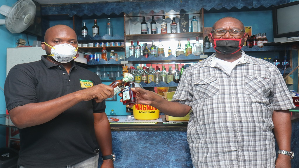 A representative of J Wray and Nephew (left) presents a package to Joslyn Stewart in Montego Bay, St James.