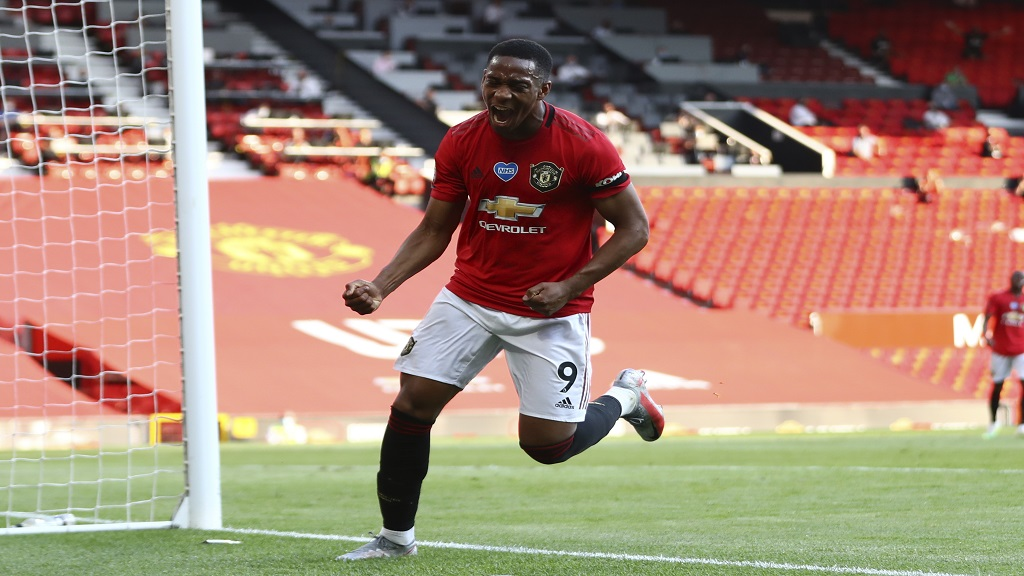 Manchester United's Anthony Martial celebrates after scoring his side's third goal during their English Premier League football match against Sheffield United at Old Trafford in Manchester, England, Wednesday, June 24, 2020. (Michael Steele/Pool via AP).