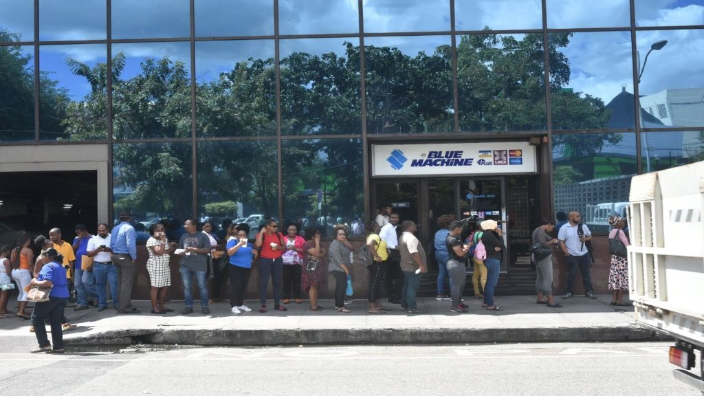 Flashback: Citizens disregard social distancing guidelines as they line up outside Republic Bank on Independence Square, Port-of-Spain.