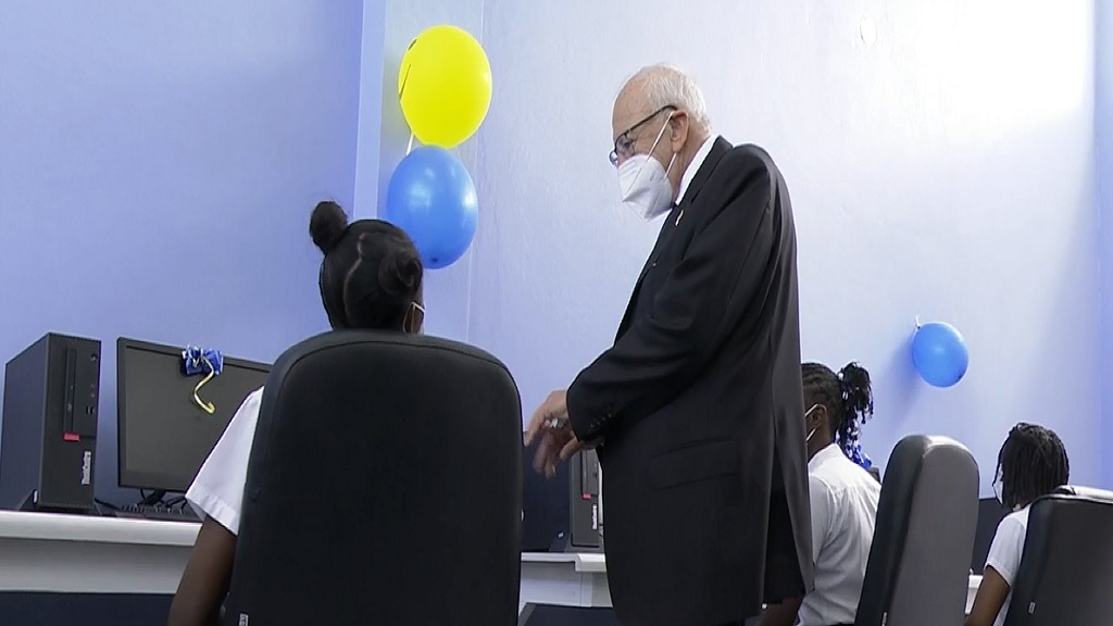 United States Ambassador to Jamaica, Donald Tapia engages with students during the official opening of the new multipurpose educational facility.
