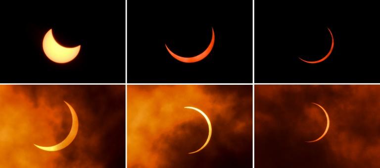 Cette combinaison de photos montre la Lune se déplaçant devant le Soleil, lors d'une éclipse annulaire, au moment du solstice d'été, observée à New Delhi le 21 juin 2020