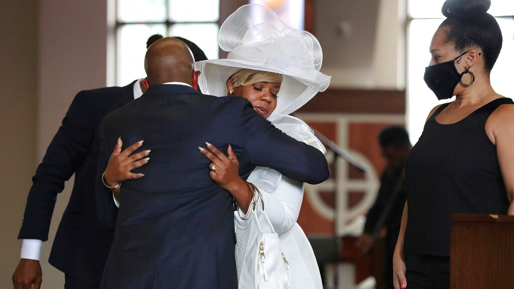 The Reverend Raphael G. Warnock, senior pastor of Ebenezer Baptist Church, comforts Tomika Miller, the wife of Rayshard Brooks during his public viewing at Ebenezer Baptist Church on Monday, Jun 22, 2020 in Atlanta. (Curtis Compton/Atlanta Journal-Constitution via AP, Pool)