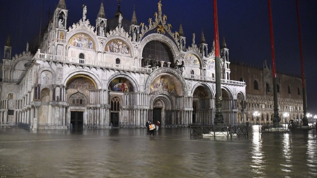A view of flooded St. Mark square in Venice, Italy, Thursday night, June 4, 2020. Venice has been submerged by a near-record high tide that is rare for this time of year. The water level in the lagoon city reached 116 centimeters late Thursday, the third-highest mark for June. That level indicates around a quarter of Venice has been flooded. (AP Photo/Luigi Costantini)