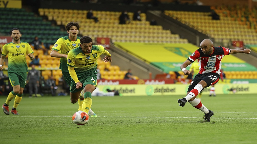 Southampton's Nathan Redmond scores his side's third goal during the English Premier League football match against Norwich City at Carrow Road in Norwich, England, Friday, June 19, 2020. (AP Photo/Richard Heathcote/Pool).
