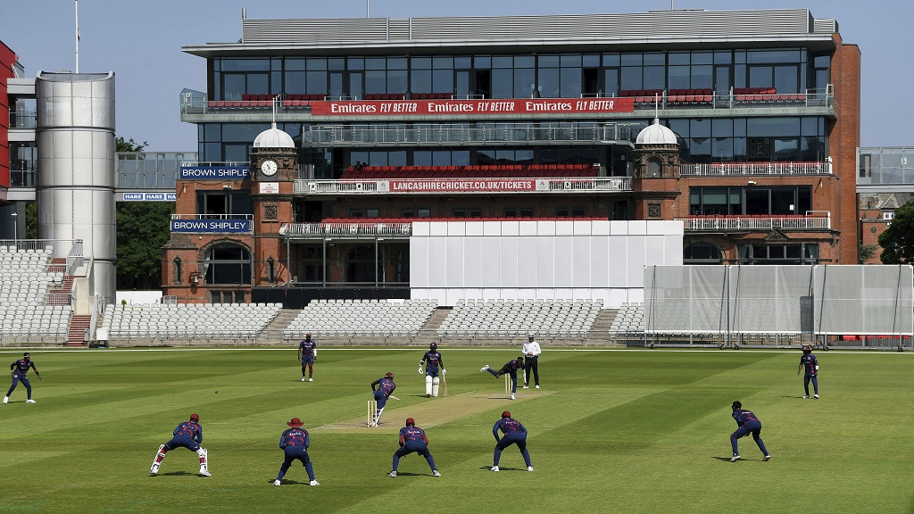 A general view of play, during day two of a West Indies warm up match at Old Trafford in Manchester, England, Wednesday June 24, 2020. Top-level cricket is being played for the first time in the world since the March coronavirus lockdown, as West Indies began their intra-squad warm-up match at Old Trafford. (Gareth Copley/Pool via AP).
