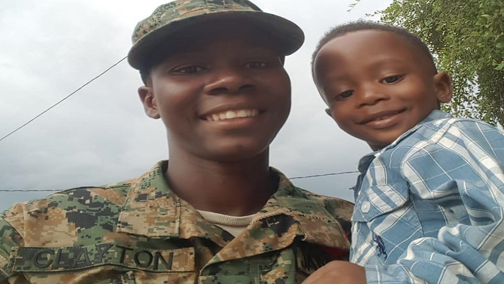 Jamaica Defence Force (JDF) soldier, Lexton Clayton, and her son, Tyler, who are believed to be numbered among three badly burnt bodies which were found in bushes in Pear Tree River district in St Thomas on Saturday afternoon.