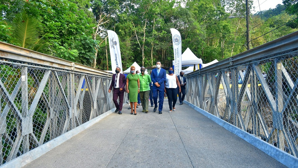 Prime Minister Andrew Holness (second right) walks across the newly commissioned bridge in the community of Bowden Hill, St Andrew, on Thursday. With the prime minister (from left) are Mayor of Kingston, Senator Delroy Williams; Member of Parliament, West Rural St Andrew, Juliet Cuthbert-Flynn; Minister of Local Government and Community Development, Desmond McKenzie; and Councillor, Stony Hill Division, Tosha Schwapp. (Photo: JIS)