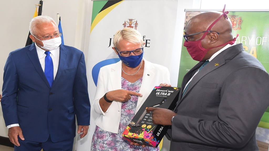 Justice Minister, Delroy Chuck (left), observes as Head of the European Union Delegation to Jamaica, Ambassador Malgorzata Wasilewska (centre), presents audio-visual equipment to Chief Justice Bryan Sykes at a handover ceremony on Friday, June 26 at the St Catherine Parish Court.