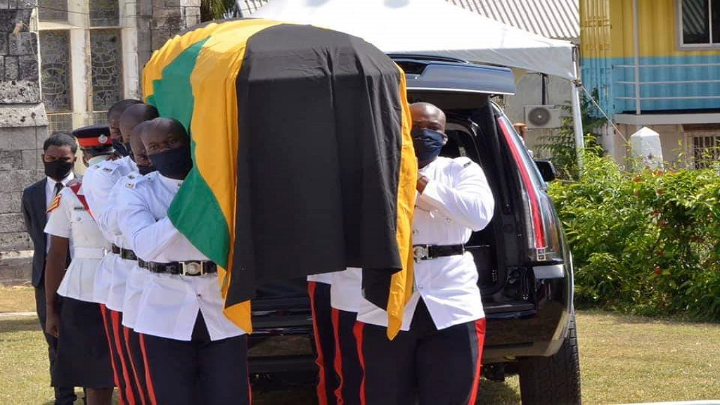 Members of the Jamaica Constabulary Force (JCF) carrying the casket of late parliamentarian, Shahine Robinson. (Photo courtesy of the prime minister's Facebook page)