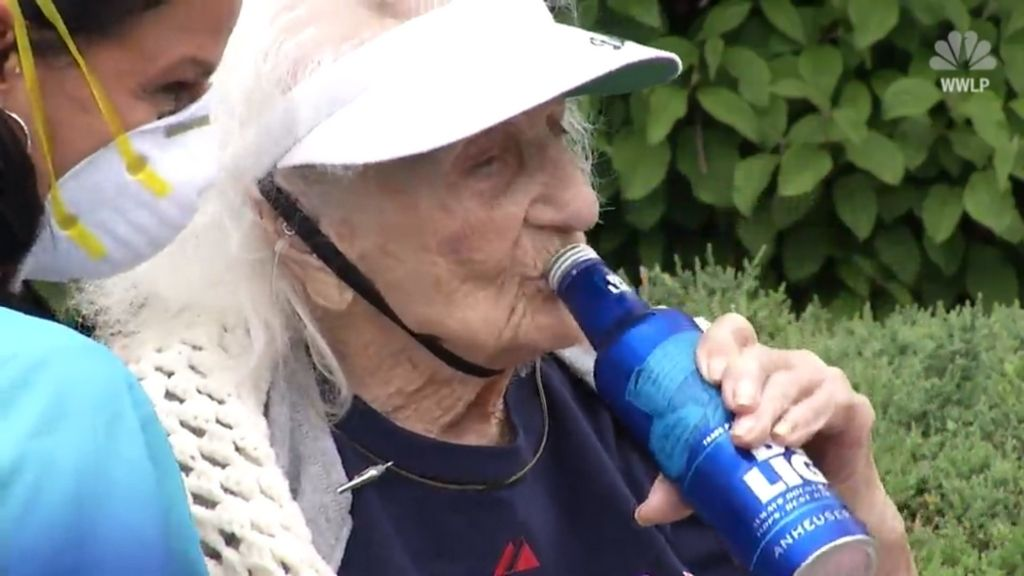 103-year-old COVID-19 survivor Jennie Stejna throws back a Bud Light for old time's sake.