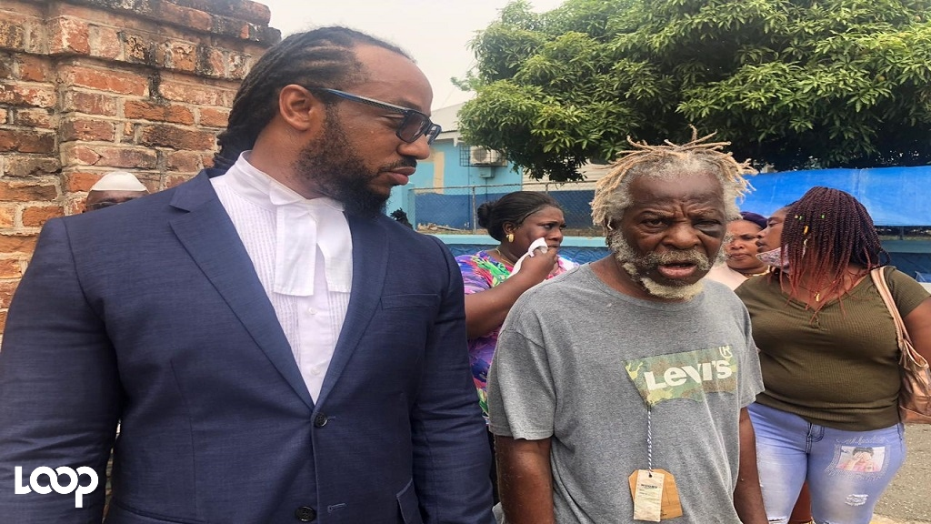 George Williams (right), the man who spent 50 years in prison without trial, outside the St Catherine Parish Court with attorney Isat Buchanan after being freed on Wednesday.