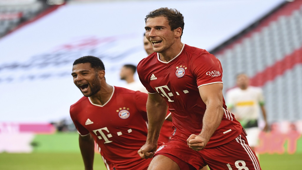 Bayern's Leon Goretzka, right, celebrates with Serge Gnabry after he scores his side second goal during the German Bundesliga football match against Borussia Moenchengladbach in Munich, Germany, Saturday, June 13, 2020. (Matthias Balk/Pool via AP).
