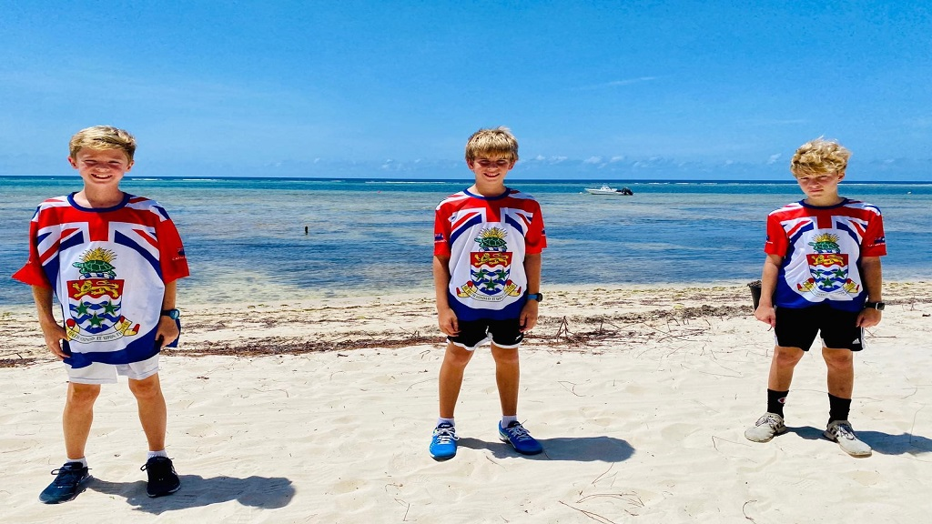 Three 12-year-old boys, Zach Brooks, Ben Coak and Jake Fagan, have pledged to kiteboard 22 miles in Grand Cayman to raise money for charity.
