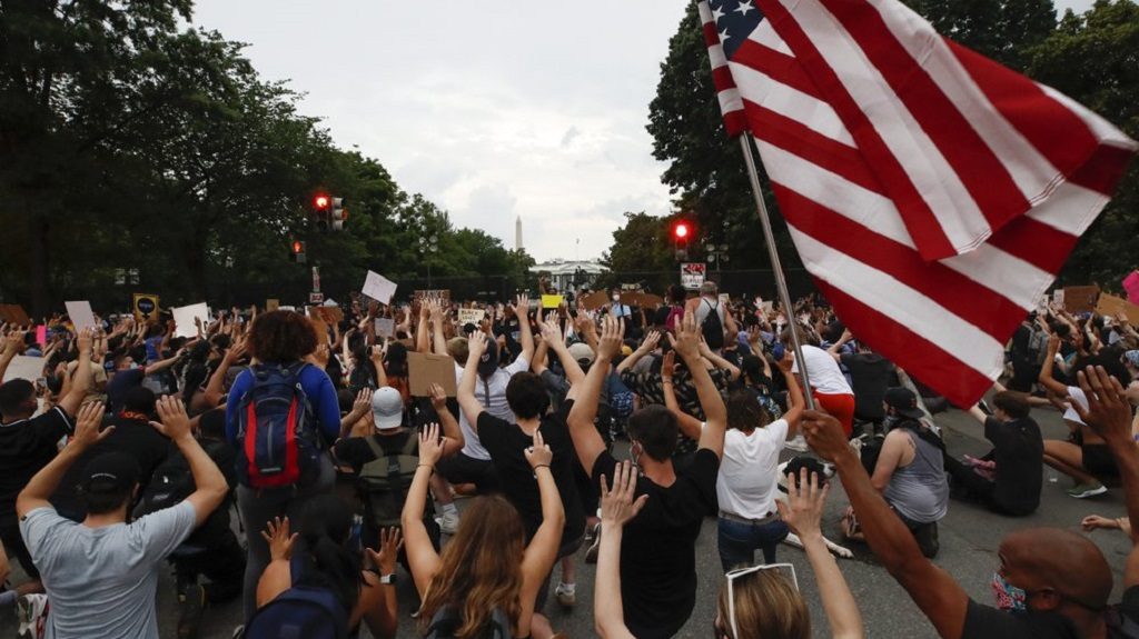 Demonstrators protest Thursday, June 4, 2020, near the White House in Washington, over the death of George Floyd, a black man who was in police custody in Minneapolis. Floyd died after being restrained by Minneapolis police officers. (AP Photo/Alex Brandon)