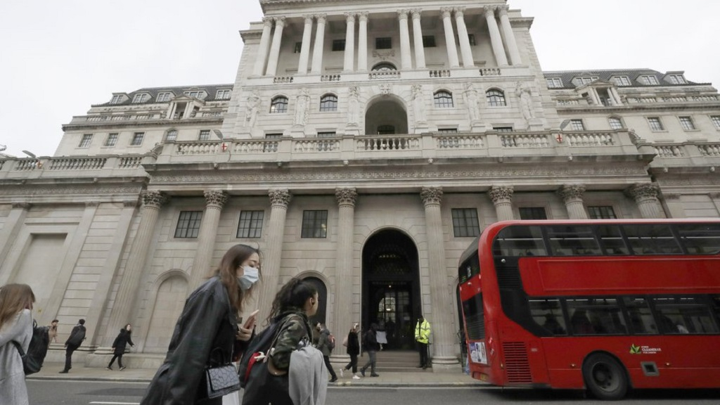 FILE - In this Wednesday, March 11, 2020 file photo, pedestrians wearing face masks pass the Bank of England in London. The Bank of England has apologized for the links past governors of the institution had with slavery. (AP Photo/Matt Dunham, file)