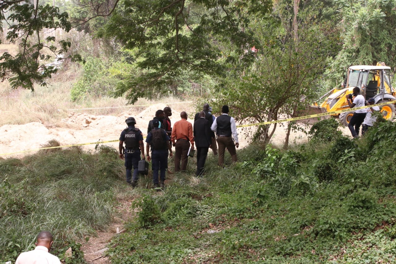 Police and other security personnel engaged in a detailed search of a property in Spanish Town, St Catherine on Tuesday.