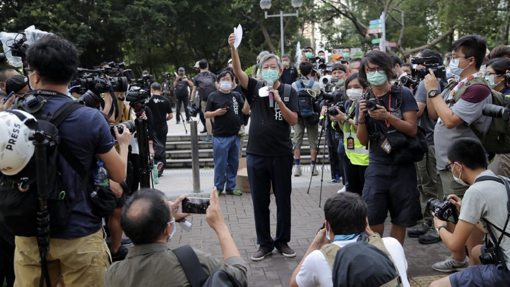 An activist comes to mourn those killed in the 1989 Tiananmen crackdown at Victoria Park in Causeway Bay, Hong Kong, Thursday, June 4, 2020. China is tightening controls over dissidents while pro-democracy activists in Hong Kong and elsewhere try to mark the 31st anniversary of the crushing of the pro-democracy movement in Beijing's Tiananmen Square. (AP Photo/Kin Cheung)