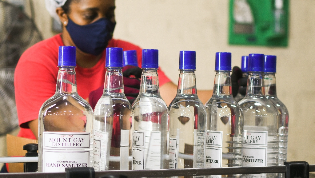 Bottles of Mount Gay Distilleries hand sanitiser on the line.