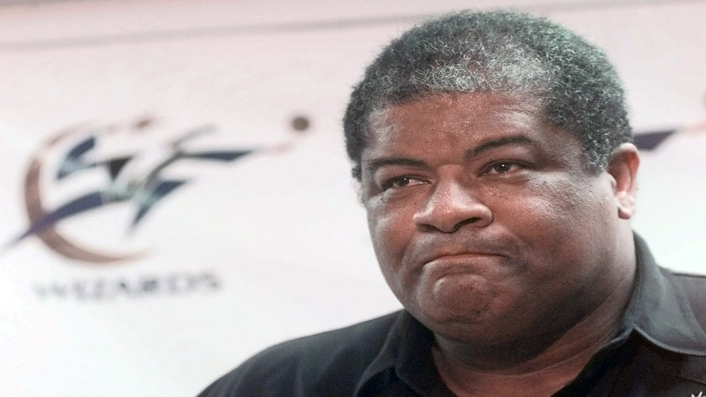 In this May 14, 1998, file photo, Washington Wizards general manager Wes Unseld announces the trade of Chris Webber to the Sacramento Kings for Mitch Richmond and Otis Thorpe at the MCI Center in Washington. Unseld died Tuesday, June 2, 2020, after a series of health issues, most recently pneumonia. He was 74. (AP Photo/Brian K. Diggs, FIle).
