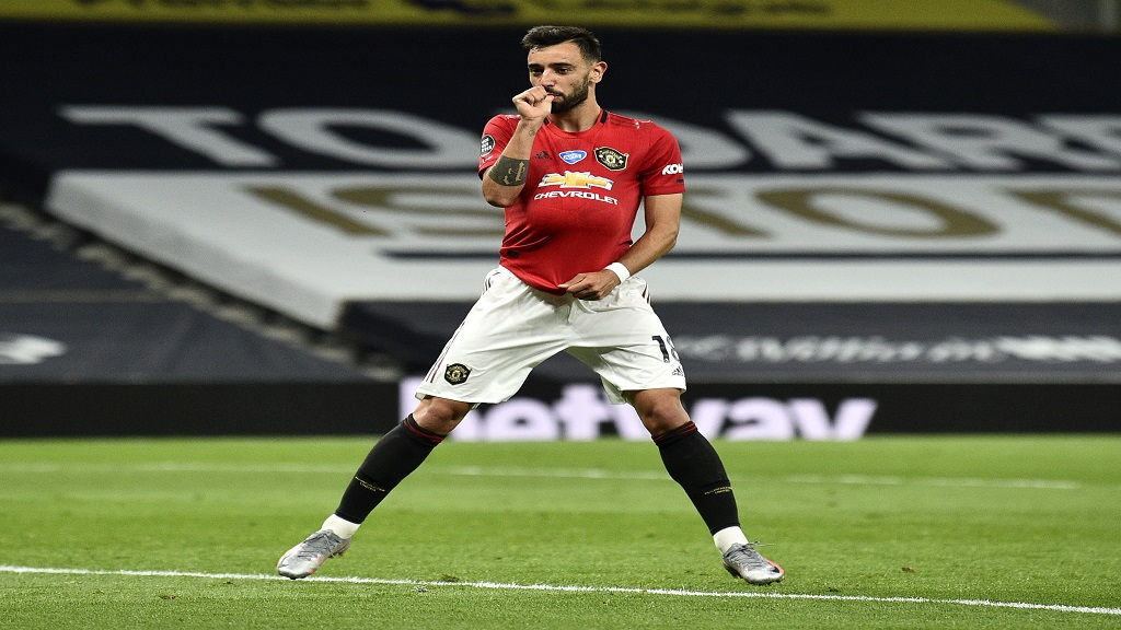 Manchester United's Bruno Fernandes reacts after kicking a penalty to level the scores during the English Premier League football match against Tottenham at the Tottenham Hotspur Stadium in London, England, Friday, June 19, 2020. (AP Photo/Glyn Kirk, Pool).