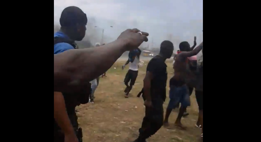 A screenshot of a video from the scene of a protest where Ornella Greaves was shot.