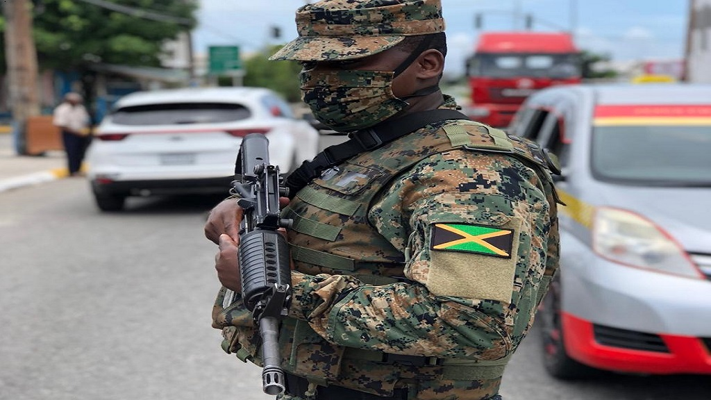 A member of the military at a state of emergency security checkpoint in Western Kingston on Sunday.
