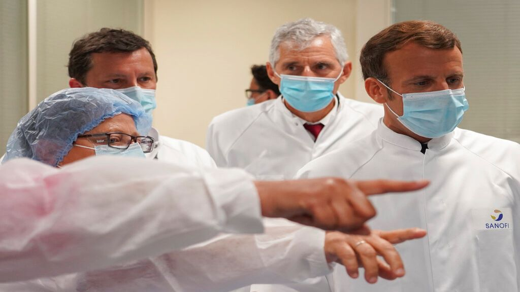 French President Emmanuel Macron listens to researchers as he visits an industrial development laboratory at French drugmaker's vaccine unit Sanofi Pasteur plant in Marcy-l'Etoile, near Lyon, central France, Tuesday, June 16, 2020. (AP Photo/Laurent Cipriani, Pool)