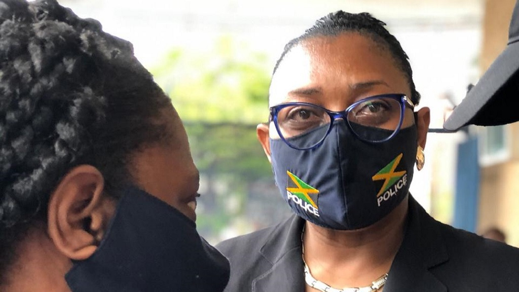 A teary-eyed Senior superintendent Stephanie Lindsay, head of the Constabulary Communication Unit, outside the Kingston Public Hospital on Tuesday following the death of superintendent Leon Clunis.