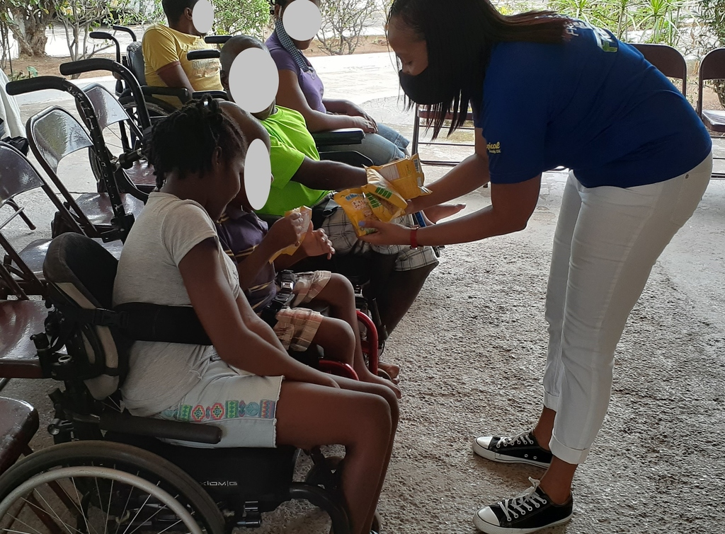 Janene Wright (right), JP St Mary's brand and sponsorship manager interacts with a few of the wards of Mustard Seed Communities during a visit on Thursday, May 21, 2020. JP St Mary's provided a nutritious breakfast along with its suite of healthy snacks in observance of Child's Month.
