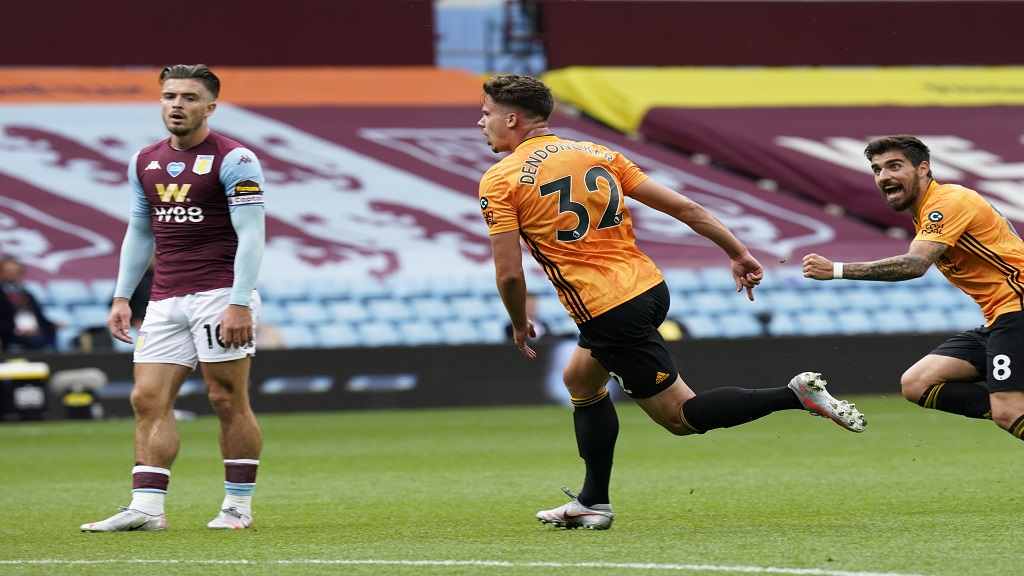 Wolverhampton Wanderers' Leander Dendoncker, centre, celebrates after scoring during the English Premier League football match against Aston Villa  at Villa Park in Birmingham, England, Saturday, June 27, 2020. (Tim Keeton/Pool via AP).