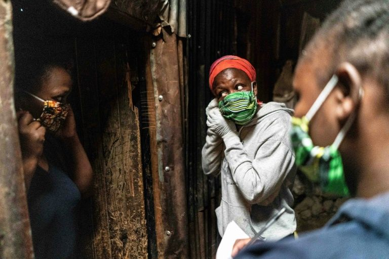 Rules and regulations differ across the globe -- but masks play a big role in the fight to limit virus contagion (AFP Photo/Fredrik Lerneryd)