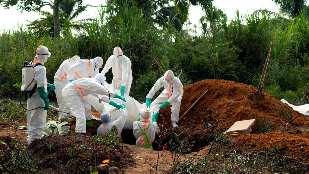 In this Sunday, July 14, 2019 file photo, an Ebola victim is put to rest at the Muslim cemetery in Beni, Congo. (AP Photo/Jerome Delay, File)