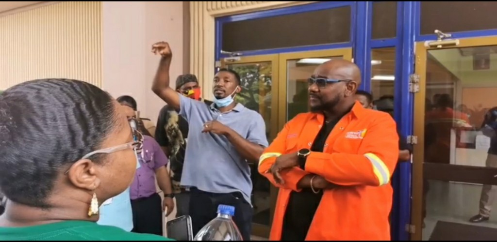 Flashback: NCRHA CEO Davlin Thomas listens to the concerns of protesting workers.