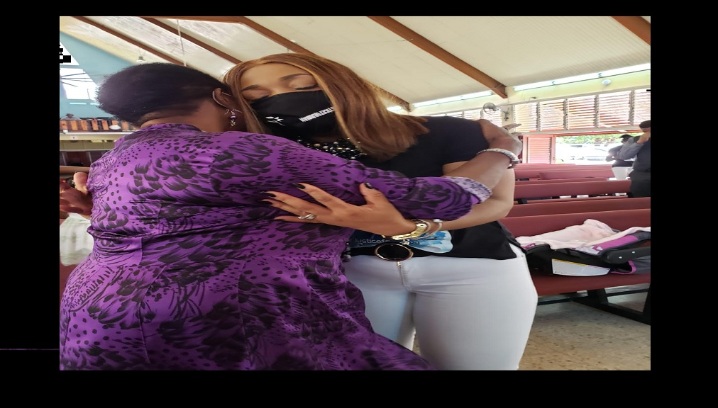 "Olivia ""Babsy"" Grange, the Minister of Culture, Gender, Entertainment and Sport tries to console Portia Haughton, mother of Jodian Fearon who died in April."