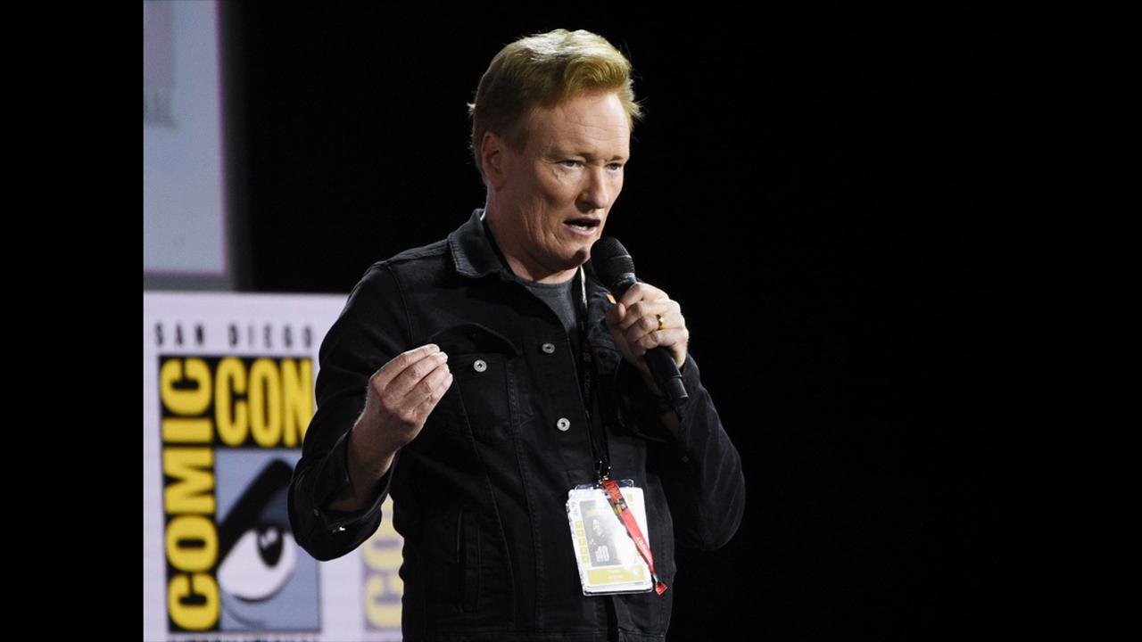 "In this July 18, 2019, file photo, Conan O'Brien introduces Tom Cruise to present a clip from ""Top Gun: Maverick"" on day one of Comic-Con International in San Diego.  (Photo by Chris Pizzello/Invision/AP, File)"