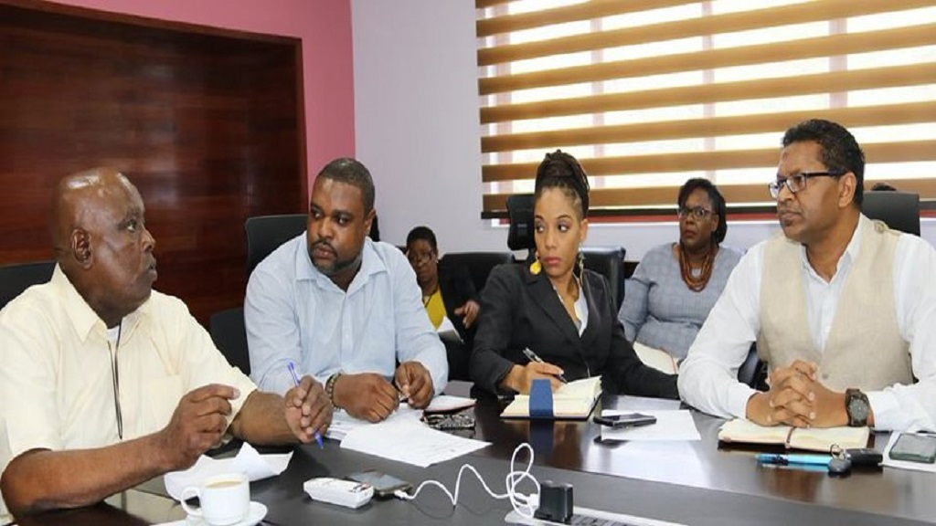 Dunstan Whittingham (left), President of the Jamaica Vendors, Higglers and Markets Association, speaking at a COVID-19 consultation meeting with industry stakeholders on March 5, 2020.
