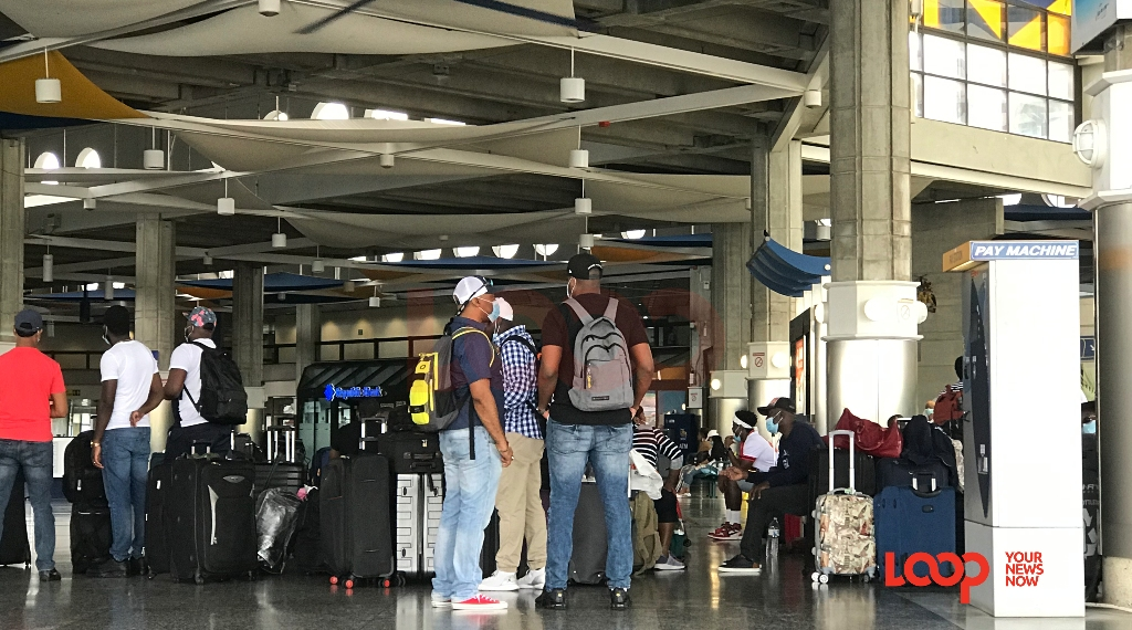 Royal Caribbean Serenade of the Seas crew checking-in at the Grantley Adams International Airport in Barbados on June 19.