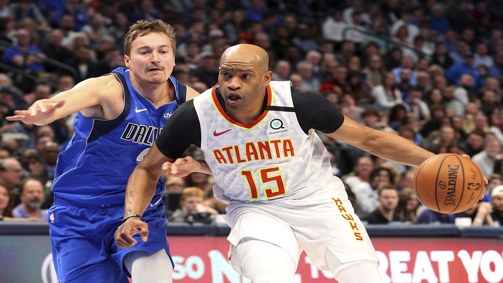 In this Feb. 1, 2020, file photo, Atlanta Hawks guard Vince Carter (15) drives to the basket against Dallas Mavericks guard Ryan Broekhoff (45) during the second half of an NBA basketball game in Dallas. (AP Photo/Richard W. Rodriguez, File).