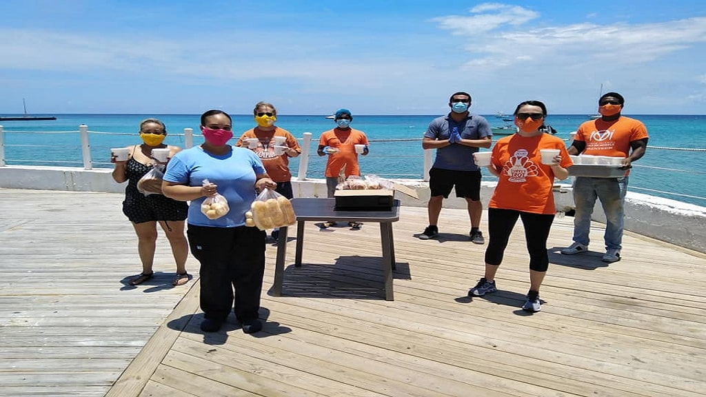 Cayman Cabana owner Luigi Moxam felt the need to assist with the efforts of Meals on Wheels by providing a special Saturday meal for seniors. Volunteers collected traditional fish tea and fresh Brac Bread for delivery to seniors.