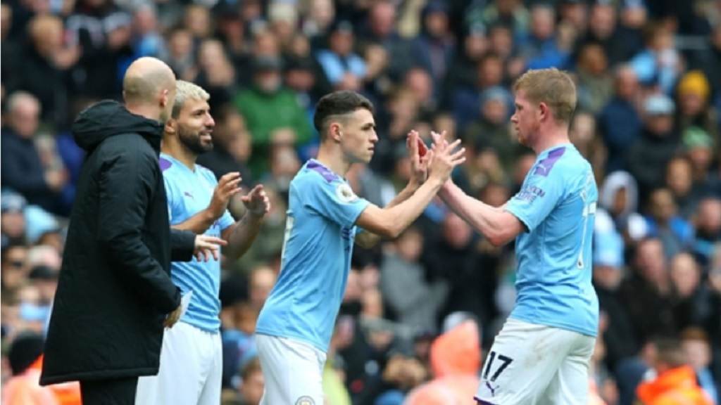 Manchester City players, (from left) Sergio Aguero, Phil Foden and Kevin De Bruyne, celebrating.