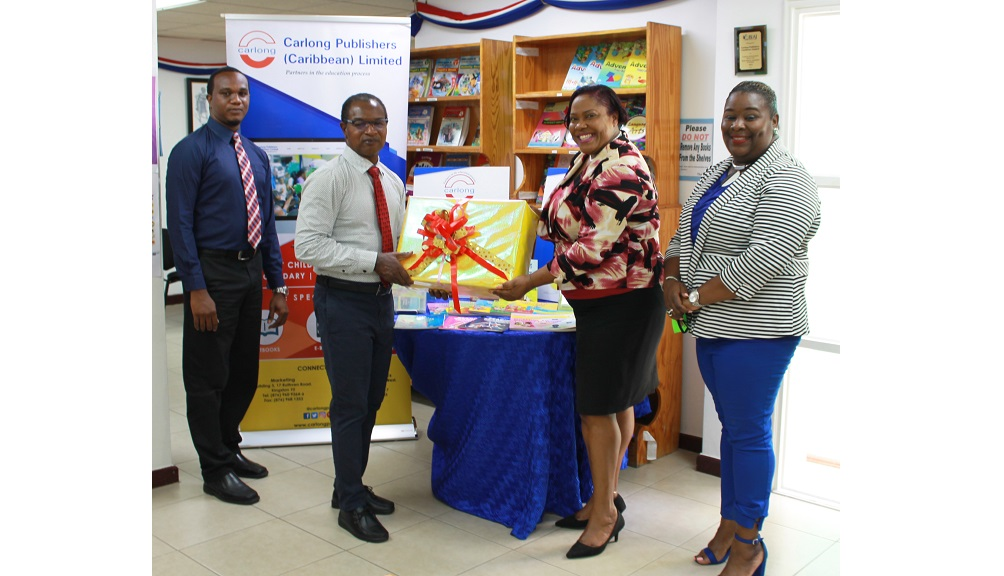 (From left) Omar Reid, IT Manager, Carlong Publishers; Vinton Samms, Marketing Manager, Carlong Publishers;