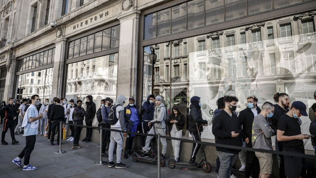 People queue outside the Niketown shop in London, Monday, June 15, 2020. After three months of being closed under coronavirus restrictions, shops selling fashion, toys and other non-essential goods are being allowed to reopen across England for the first time since the country went into lockdown in March.(AP Photo/Matt Dunham)