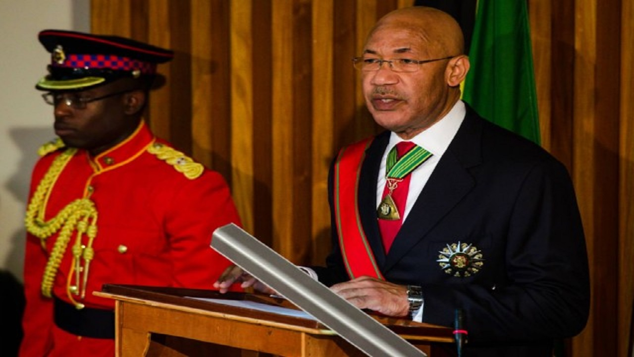Governor-General, Sir Patrick Allen, wearing the insignia that is now in focus locally while addressing Parliament. (File photo)