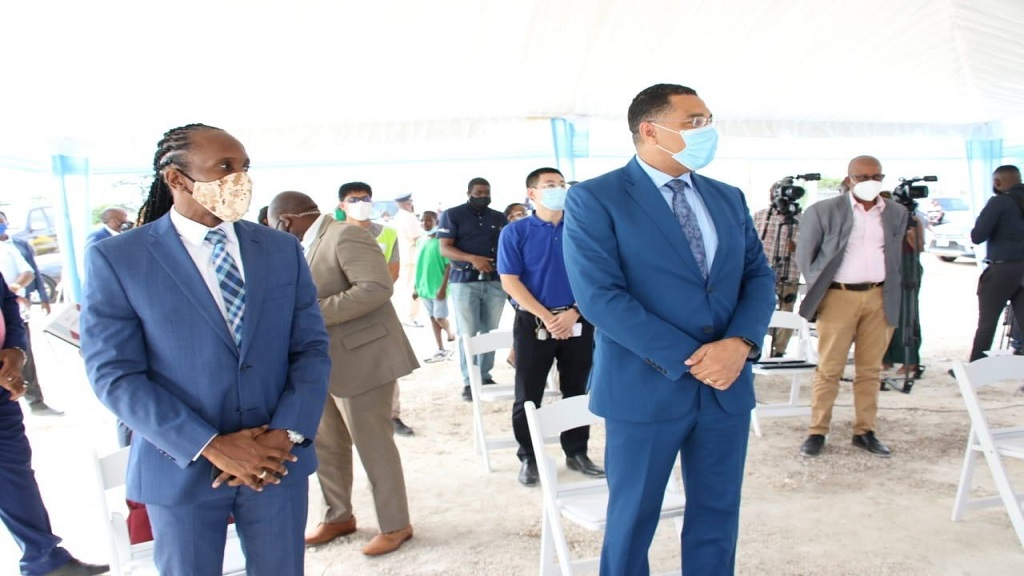 Prime Minister Andrew Holness (right foreground), along with East Central St Catherine Member of Parliament (MP), Alando Terrelonge, at the ground-breaking ceremony for the Catherine Estate housing development in the parish on Wednesday.