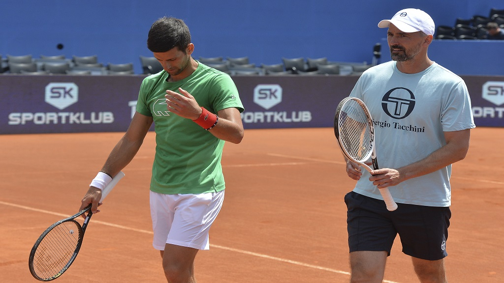 In this photo taken June 18, 2020, former Wimbledon champion Goran Ivanisevic, right, who now coaches top-ranked Novak Djokovic, left, attends a training session during an exhibition tournament in Zadar, Croatia. (AP Photo/Zvonko Kucelin).
