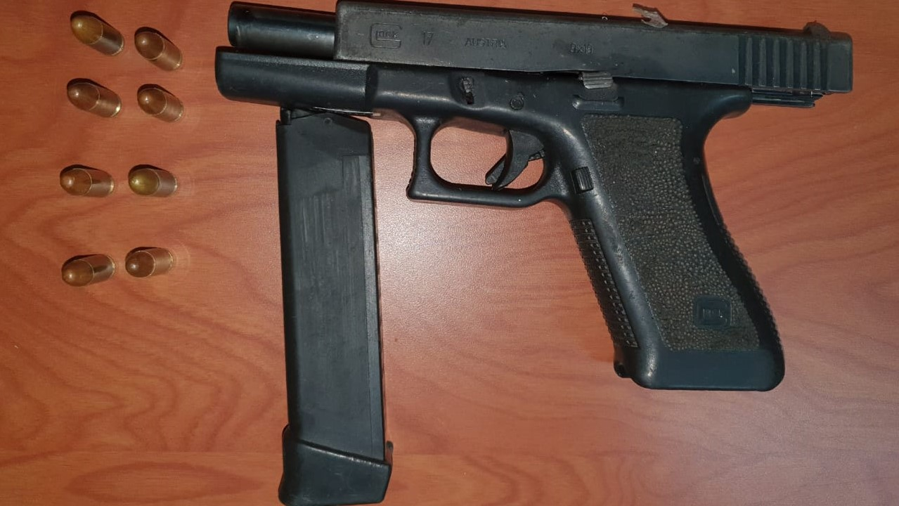A Glock 17 pistol loaded with eight rounds of ammunition was found on the suspect as he was detained.