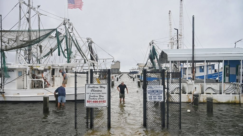 Owners tie down and secure their boats in the Pass Christian Harbor in Pass Christian, Miss., Sunday, June 7, 2020, on the Mississippi Gulf Coast ahead of Tropical Storm Cristobal's landfall. (Lukas Flippo/The Sun Herald via AP)
