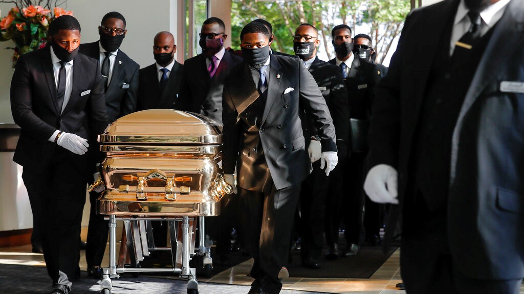 Pallbearers bring the coffin into The Fountain of Praise church in Houston for the funeral for George Floyd on Tuesday, June 9, 2020. (Godofredo A. Vásquez/Houston Chronicle via AP, Pool)